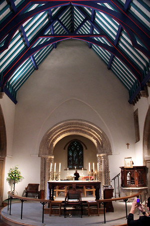 Nave Altar and Pulpit in front of the Norman Arch, with the Chancel and East Window beyond. 15 July 2011