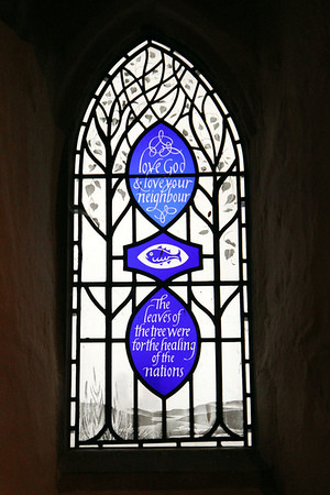 """The """"Fish"""" Good Neighbour Window. This commerates a scheme started by the Vicar and Parishioner in the middle of the twentieth century. 15 July 2011"""