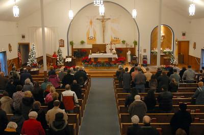 Parishioners of St. Hugh Parish attend mass at a new time of 4 p.m. instead of 5 p.m. Saturday Jan. 5 2013.  Erica Benson—ebenson@shawmedia.com