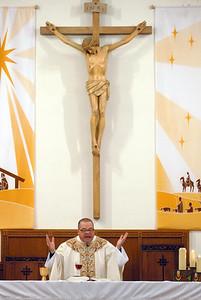 The new pastor of St. Hugh Parish, Marc Reszel delivers mass at a new time of 4 p.m. instead of 5 p.m. Saturday Jan. 5 2013.  Erica Benson—ebenson@shawmedia.com