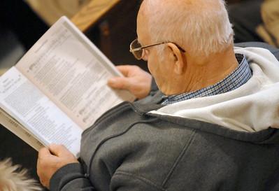 Parishioners of St. Hugh Parish including Terry Salvino of Lyons attend mass at a new time of 4 p.m. instead of 5 p.m. Saturday Jan. 5 2013.  Erica Benson—ebenson@shawmedia.com