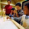 "Kiah Boyd, left, her brothers, Donovan, Ian and Micah, light candles and pray before the Sunday  service at St Luke Orthodox Christian Church in Erie.<br /> For more photos of the church, go to  <a href=""http://www.dailycamera.com"">http://www.dailycamera.com</a>.<br /> Cliff Grassmick / September 5, 2010"