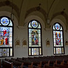 A view of the windows on the western side of the nave depicting the Glorious Mysteries. St. Mary of the Assumption Church had all its stained glass windows restored and re-installed. The project cost nearly half a million dollars and 11 years of saving and planning.