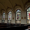 A view of the windows on the western side of the nave. These windows depict the Glorious Mysteries. St. Mary of the Assumption Church had all its stained glass windows restored and re-installed. The project cost nearly half a million dollars and 11 years of saving and planning.