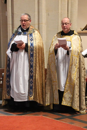 "Provost Kelvin Holdsworth and Vice Provost Cedric Blakey joining in the singing of ""Of the Father's love begotten"" 24 December 2014"