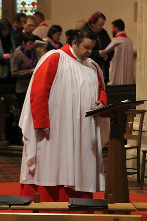 "Frikki Walker waiting at his lectern for the choir to return in procession during ""From heav'n above to earth I come"" (Tune von Himmel Hoch) 24 December 2014"