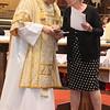 Church Warden presenting a few cards to Kelvin.
