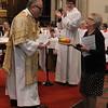 Kelvin receiving a cake from a Church Warden