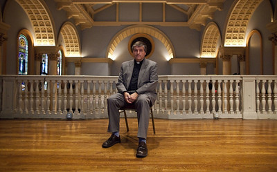 """Fr. Helmut Schüller sits for a photograph July 16 at Judson Memorial Church in New York before his first talk as part of his """"The Catholic Tipping Point"""" tour. (photo by Ramin Talaie for the National Catholic Reporter)"""