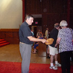 Fr. Helmut collects red ribbons in Portland, OR