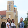Transfiguration Greek Orthodox Church in Lowell recently had their domes painted blue, after decades of them being unpainted. From left, sisters Kasandra, 15, Savannah, 12, and Ariana Rios, 14, of Lowell, who were on their way to vacation church camp. They hadnt noticed the dome painting, but like it. (SUN/Julia Malakie)