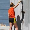 Volunteers from U.M. ARMY (United Methodist Action Reach-out Mission by Youth) help with home repairs at two houses in Chelmsford. Kelly Velehoski, 17, of Mountain Top, Pennsylvania, helps paint a shed at Eileen Bergeron's house in Chelmsford. (SUN/Julia Malakie)
