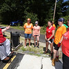 Volunteers from U.M. ARMY (United Methodist Action Reach-out Mission by Youth) help with home repairs at two houses in Chelmsford. Homeowner Andra Lamarche of Chelmsford talks with UM Army volunteers, from left, Emily Latshaw, 15 of Toms River, NJ, Alyssa Carey, 16, of Cheshire, CT, Allie Bennett, 16, of Milford, CT, Sara Davies, 16, of Milford, CT, and April Parsons of Farmington, CT. (SUN/Julia Malakie)