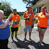 Volunteers from U.M. ARMY (United Methodist Action Reach-out Mission by Youth) help with home repairs at two houses in Chelmsford. From left, homeowner Eileen Bergeron of Chelmsford, and volunteers Danny Schieder, 17, of Toms River, N.J., Ken McFarland of Shelburne, Vt, and Maggie Ray, 18, of Menomonee Falls, Wisconsin. (SUN/Julia Malakie)