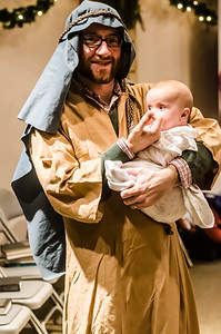 Saint Joseph and the baby Jesus prepare for their big entrance.
