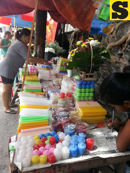 Candles in different colors and sizes are for sale outside the Carreta Cemetery, Cebu City. (Phoebe Antonio/Aireen Miñoza/Sunnex)