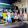 A family enters a bus at the Cebu South Bus Terminal.
