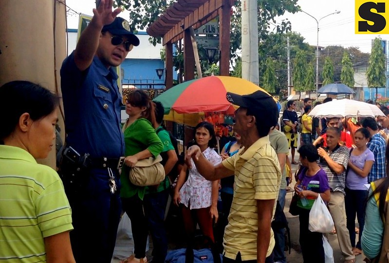 A policeman gives direction to a citizen at the Cebu South Bus Terminal on Friday, November 1, 2013.