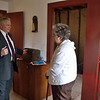 """Sally with a missionary guide in the later home of the Smith family, called the """"frame"""" home.  It was in this home that Moroni appeared and revealed to Joseph where the Book of Mormon plates were deposited."""