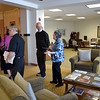 Sister Elizabeth Westgerdes shows visitors the library and second floor rotunda