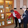 Sister Barbara Jean Backs points to an item in a case filled with artifacts of Mother Brunner on the second floor rotunda of Salem Heights