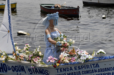 Devotes of Afro-Brazilian religions give offerings into the sea in the Guanabara bay to the African deity of the sea and fertility, Yemanja, Rio de Janeiro, Brazil, February 2, 2011. The festival day corresponds with the Roman Catholic feast of Nuestra Senora de Navegantes, Our Lady of Seafarers, which is also celebrated in Rio de Janeiro. She is also known as the sea-goddess and his devotes give in the sea offerings with flowers, perfumes and wines. Transported by West African slaves to the Americas throughout the hundreds of years of the existence of slavery in the New World. (Austral Foto/Renzo Gostoli)