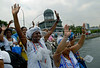 Devotees of Afro-Brazilian religions honor, dancing and singing around flowers and other offerings, in front of Guanabara bay, the African deity of the sea, Yemanja, Rio de Janeiro, Brazil, Jan. 31, 2008. The festival day corresponds with the Roman Catholic feast of Nuestra Senora de Navegantes, Our Lady of Seafarers, which is also celebrated in Rio de Janeiro.  She is also known as the sea-goddess and his devotes give in the sea offerings with flowers, perfumes and wines. Transported by West African slaves to the Americas throughout the hundreds of years of the existence of slavery in the New World.<br />  ((Austral Foto/Renzo Gostoli))