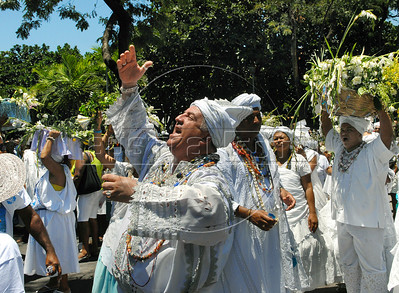 Devotees of Afro-Brazilian participate at festivity of Iemanja, the African deity of the sea and fertility, Rio de Janeiro, Brazil, February 2, 2010. The festival day corresponds with the Roman Catholic feast of Nuestra Senora de Navegantes, Our Lady of Seafarers, which is also celebrated in Rio de Janeiro. She is also known as the sea-goddess and his devotes give in the sea offerings with flowers, perfumes and wines. Transported by West African slaves to the Americas throughout the hundreds of years of the existence of slavery in the New World. (Austral Foto/Renzo Gostoli)