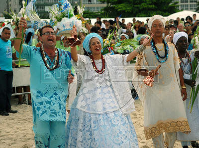 Devotees of Afro-Brazilian religions honor, dancing and singing, the African deity of the sea and fertility Yemanja, to ask for a lucky 2010, during a ceremony at Copacabana beach, Rio de Janeiro,  Brazil, December 29, 2009.  (Austral Foto/Renzo Gostoli)
