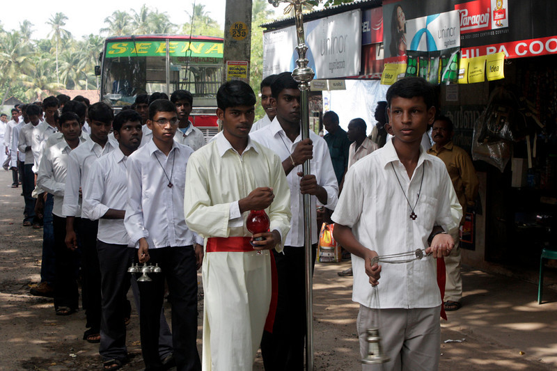 Before  beginning Mass there is a procession in the street.