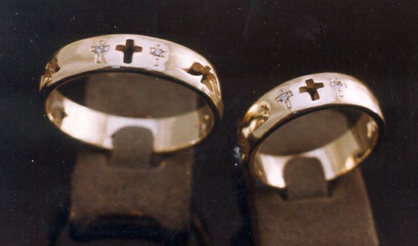 These wedding bands were created to depict the cross of Christ and the two thieves crucified with him.  Gold was provided by the couple to create them.