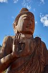 Buddha Sidhartha Buddhist wood statue sunset