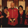 Bob, wearing his Irish Guards uniform, is surrounded by the lovely Lady Songsters.