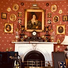 Bob's beautiful living room features English wallpaper, and the house includes 13 antique clocks and three tall grandfather clocks.