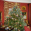 This Christmas tree in the oval living room preceded the 32-foot tree that was ultimately placed at the main staircase.