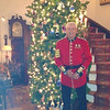 Debonair in his Irish Guards uniform, like the one Prince William wore at his wedding, Bob stands in front of the 32-foot Christmas tree.