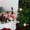 Christmas figurines are on display under the stairs next to the Christmas tree.