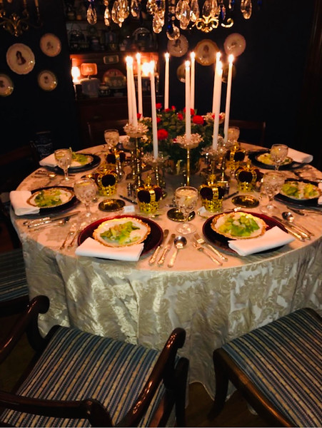 Bob's Christmas table in 2019 included host gifts of miniature crowns purchased by two of the guests at Buckingham Palace.