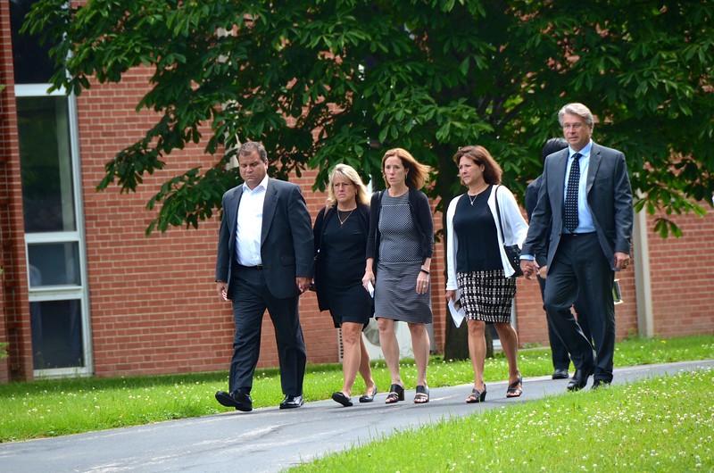 The family walks toward the mausoleum