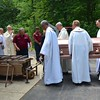 The pallbearers carry Fr. Yost