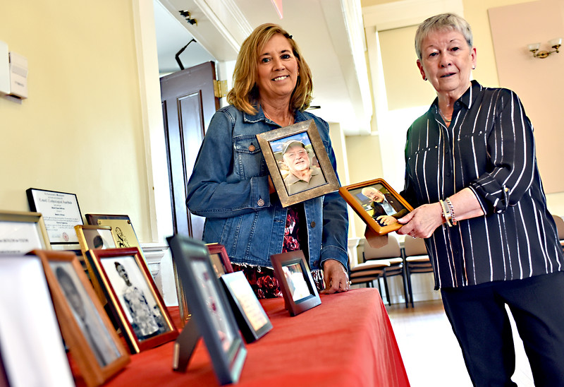 Holding recent photos of Richard DeFreitas is his daughter Vicki (DeFraitas) Smith and his wife Pat DeFreitas, they are at a Musical Tribute to him at the Chelmsford Center for the Arts. SUN/David H. Brow