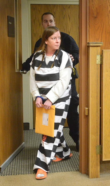 . Ruth Podzol, 38 of Walled Lake, enters Judge Jodi Debbrecht Switalski\'s courtroom for her preliminary exam at 51st District Court in Waterford. Podzol is charged with first-degree felony murder and carjacking in the death of Clifford Van Hayward.    Wednesday, February 4, 2015.  Tim Thompson-The Oakland Press