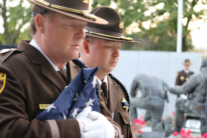 Oakland County Sheriff's Deputies and Honor Guard members Pat Weir and Robert Liddell carry the American flag for the flag raising ceremony.            (Aileen Wingblad/Digital First Media)