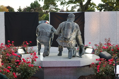 The memorial includes a life-size bronze statue of a police officer and firefighter, kneeling side by side. (Aileen Wingblad/Digital First Media)