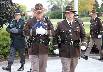 Deputies Pat Weir and Robert Liddell participated in the flag raising ceremony. (Aileen Wingblad/Digital First Media)