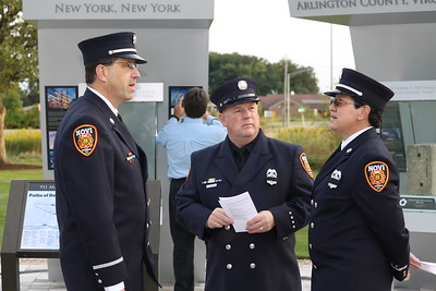 Novi officers, chatting at the Michigan Fallen Heroes Memorial, were among the law enforcement, firefighters and others who attended the ceremony. (Aileen Wingblad/Digital First Media)
