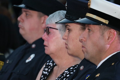 Family and other supporters of Edward Switalski, chief of the Comstock Fire Department who was among the nine fallen heroes honored at this year's ceremony. (Aileen Wingblad/Digital First Media)