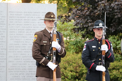 Officers stand before the Lost Heroes Wall. (Aileen Wingblad/Digital First Media)