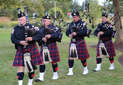 Metro Detroit Police and Fie Pipes and Drums processional at Sept. 11 Remembrance Ceremony. (Aileen Wingblad/Digital First Media)