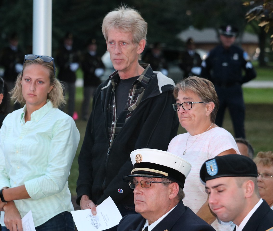 Family members of fallen officer Collin Rose of the Wayne State University Police Department, stand as his name is read during the ceremony.  (Aileen Wingblad/DIgital First Media)